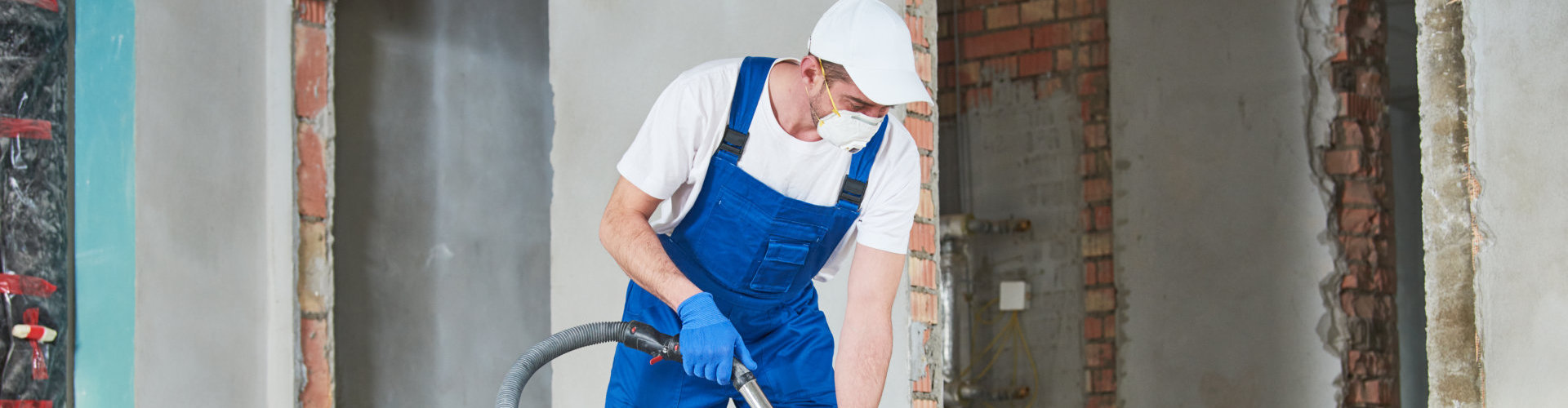 man wearing protective uniform while cleaning