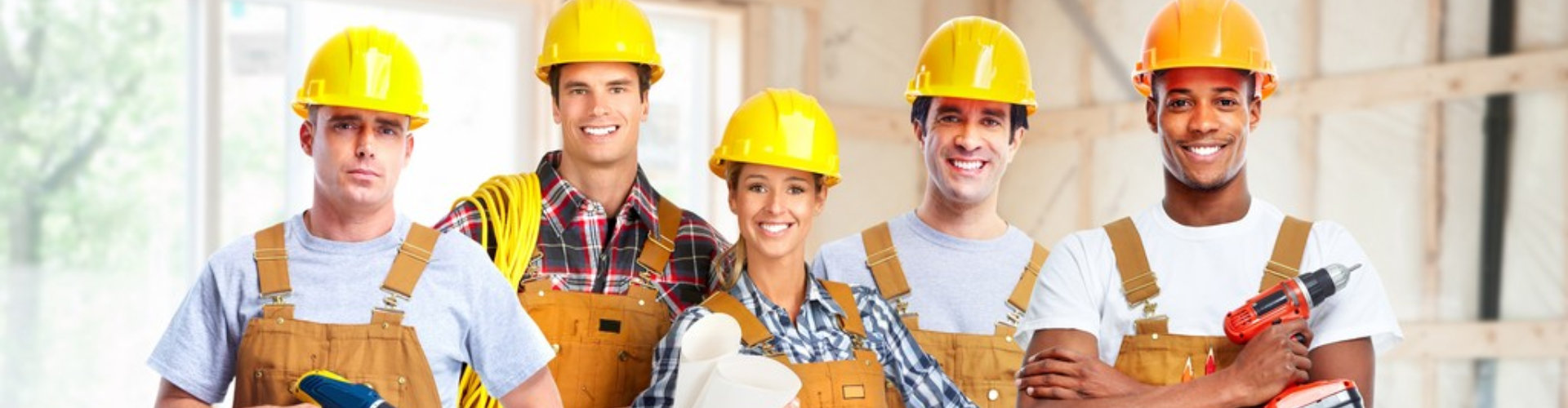 Group of professional construction workers in new house